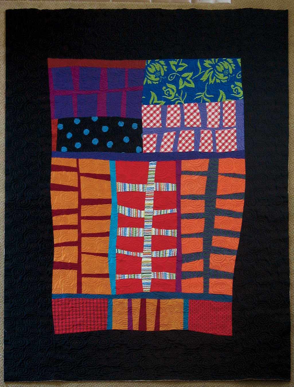 """Spines, 63½"""" x 83˝, 2013, by Pam Rocco. An original design made during Mike McNamara's improvisational quilting class at SueDee's Fabrics, Knitting and More in Scotts Valley, California."""
