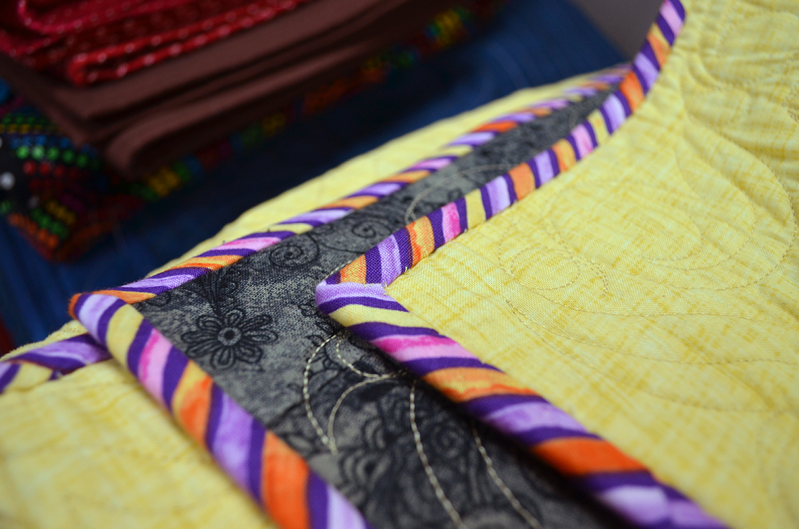 The quilt's binding is, literally, the finishing touch, and every quilter seems to have a signature style. What's your method?