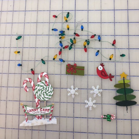 Anissa's embellishments included snowflakes, fussy-cut applique patches and a strand of tiny Christmas lights