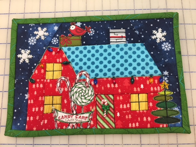 Anissa's completed First Snow house mini quilt