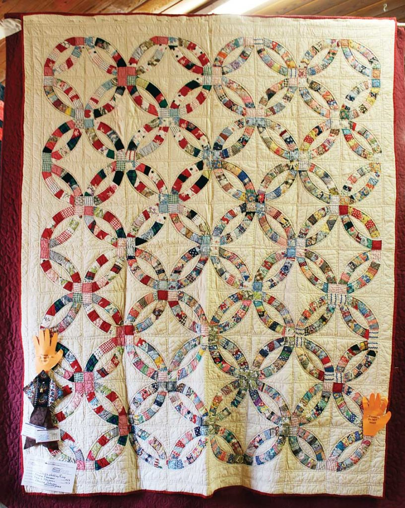 A Double Wedding Ring quilt on display at the Annual Quartz, Quiltz, and Craftz Festival, Mount Ida, Arkansas. Photo courtesy Mount Ida Area Chamber of Commerce.