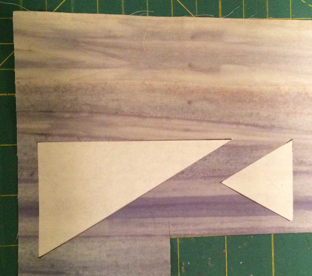 Freezer paper templates, traced from the foundation pattern, then positioned on the fabric and pressed in place.