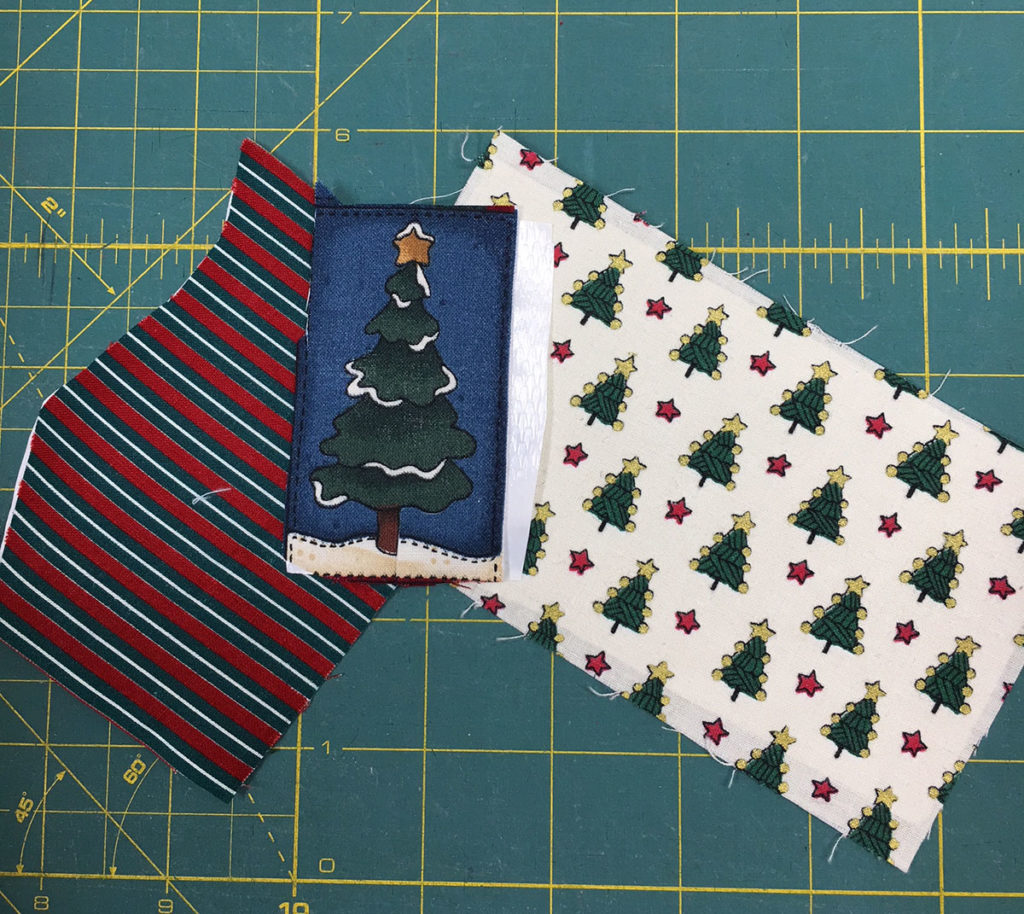 Christmas fabrics from Lori's stash for fussy cutting applique patches