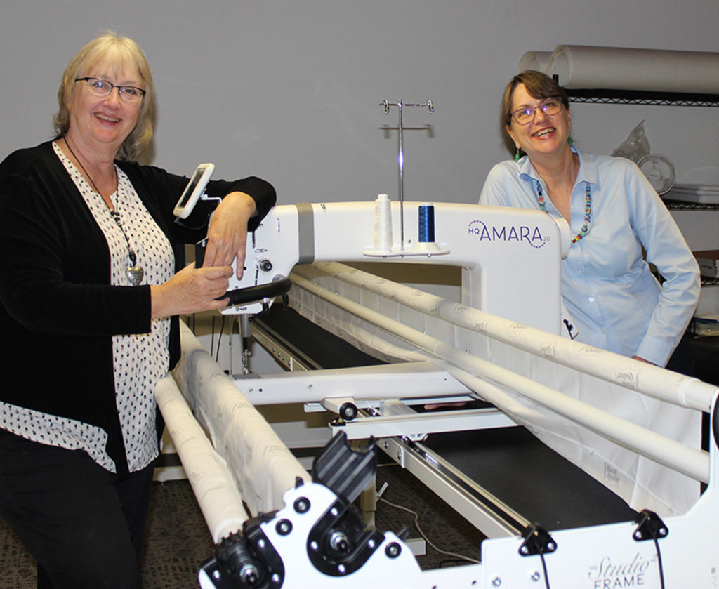 Editors Rose DeBoer and Kristine Lundblad watched patiently as the machine was being assembled in our conference room.