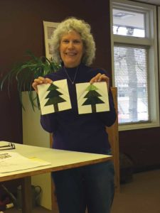 Ginger Hildred of the UFOers of Denver shows the foundation-pieced trees she made for A Bitty Christmas.