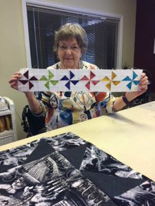 Sandy Crawford of the UFOers of Denver shows the pinwheels she made for A Bitty Christmas.