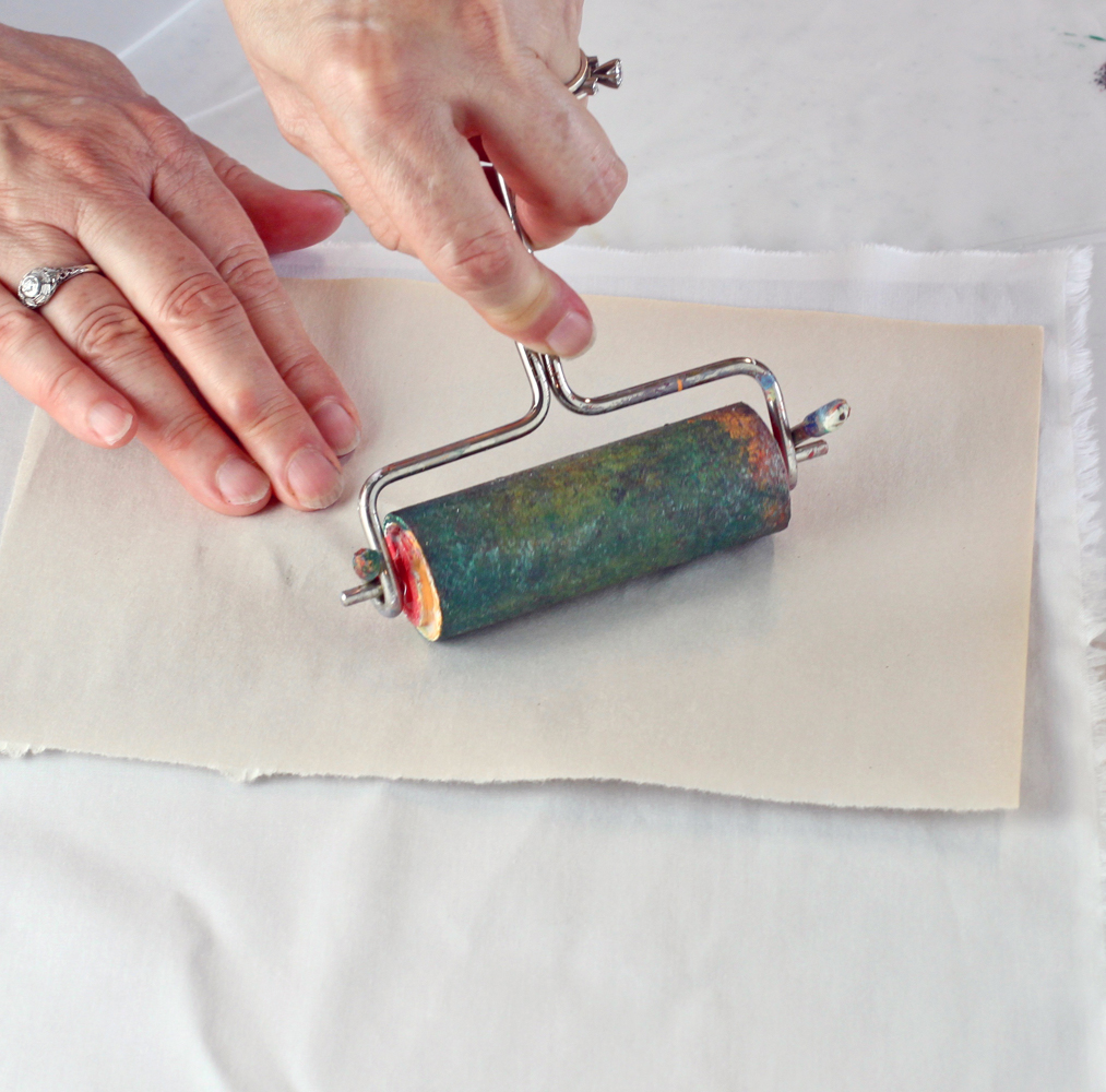 Roll the brayer over the leaf to transfer the print to the fabric