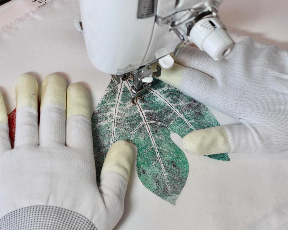 Add machine stitched veins and details
