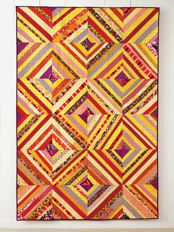 Scraps are perfect for sewing into new quilts, and are especially fun to sew with a group for a collaborative project, such as this Picnic Quilt from Quilt Giving by Deborah Fisher.
