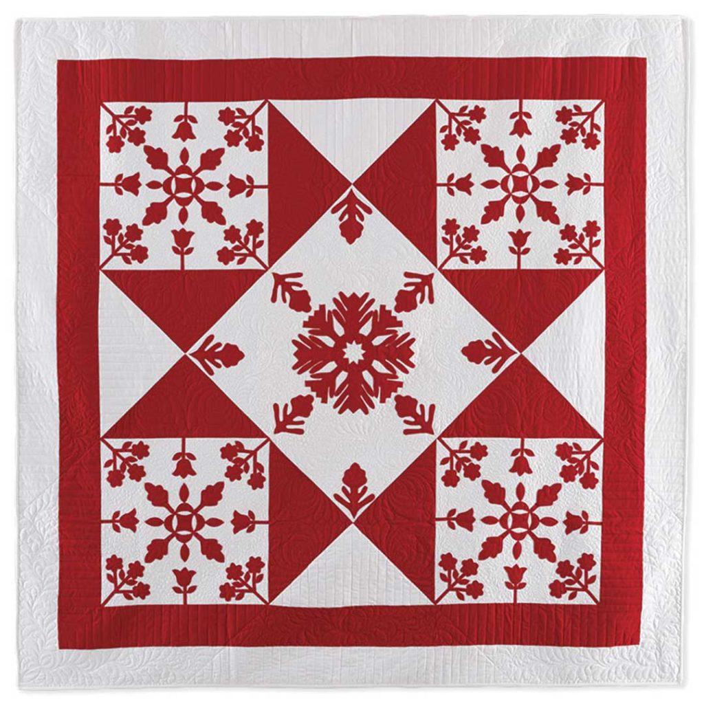 Coordinate a quilt's batting color with the lightest color fabric in the quilt. (Shown here: The Starry Flower Garden Quilt from Red & White Quilting.)