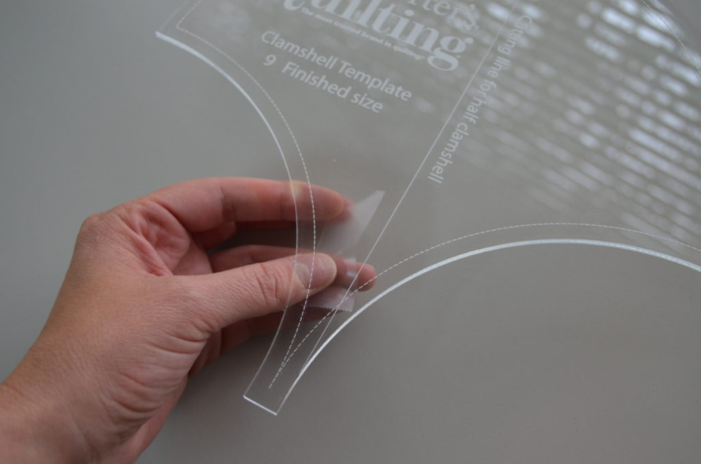Here's a favorite quilting tip—apply double-sided transparent tape to your template to keep it from slipping as you cut.