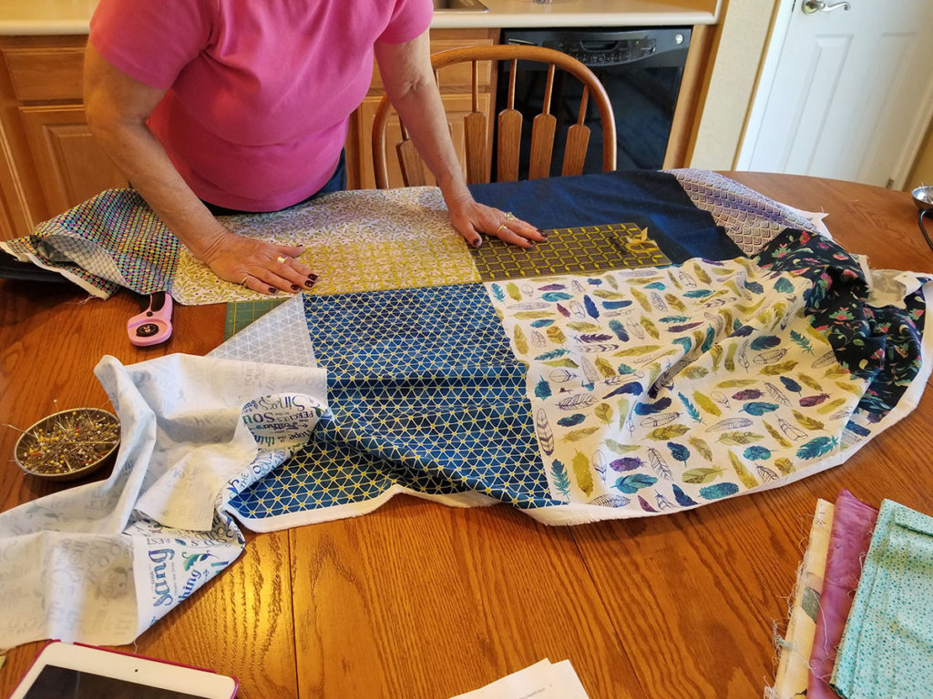 Cutting the fabric for the second month of the All A Twitter BOM
