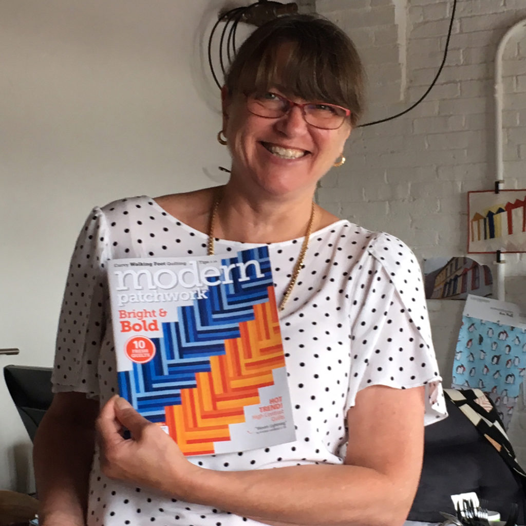 Kristine is our office rock star! Her quilt is amazing and looks great on the cover of the most recent Modern Patchwork magazine.
