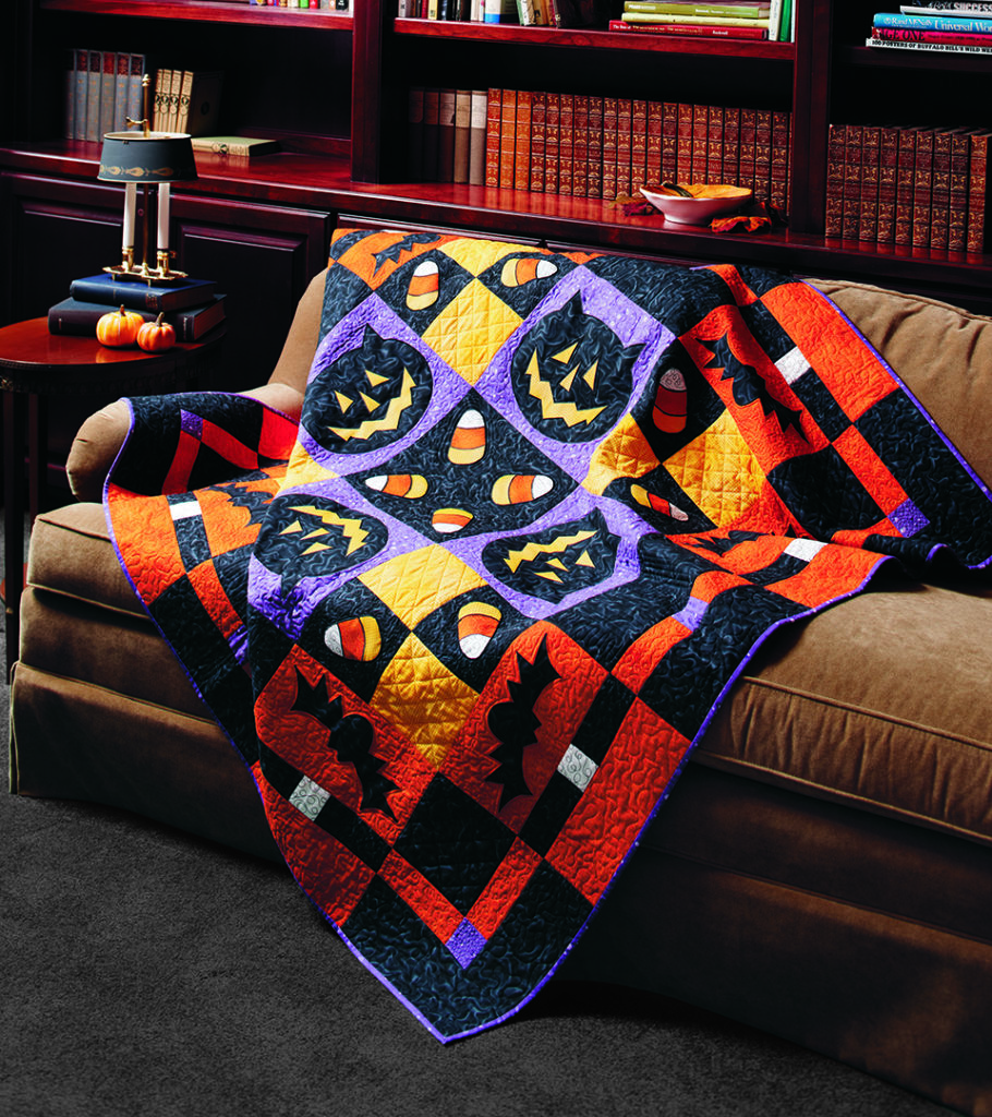 Simple piecing and simple appliqué combine to make an amazing Halloween quilt. Don't you want to cuddle under this while waiting for trick-or-treaters on your front porch?