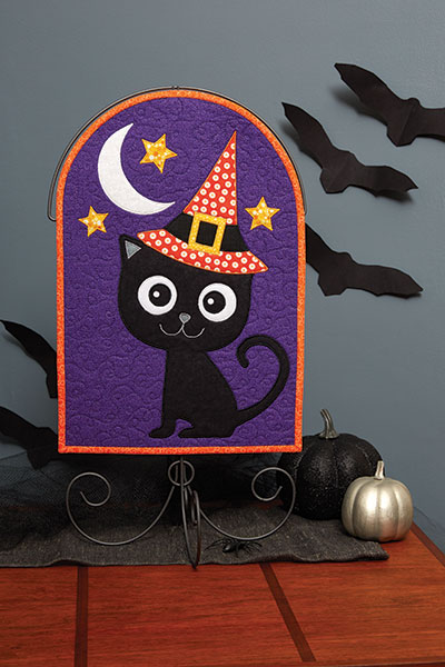 The happy smile and sweet whiskers on this black cat makes for inviting Halloween décor!