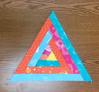 Finished paper-pieced triangle block