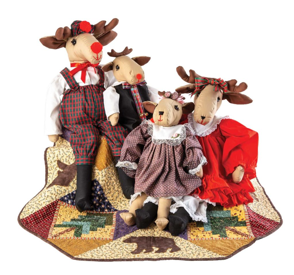 Anissa's reindeer family, made from McCalls Crafts pattern 4532, sit atop a tree skirt she made from a Debbie Mumm pattern.