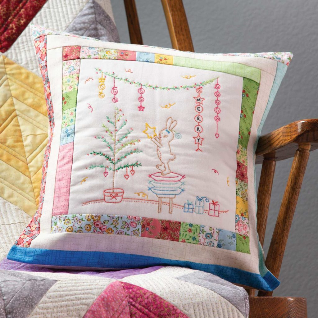 Hoppy Holidays embroidered pillow by Wendy Sheppard
