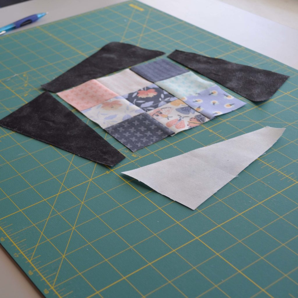 After sewing your Nine-Patch units, lay out your pieces, making sure there are arranged accurately.