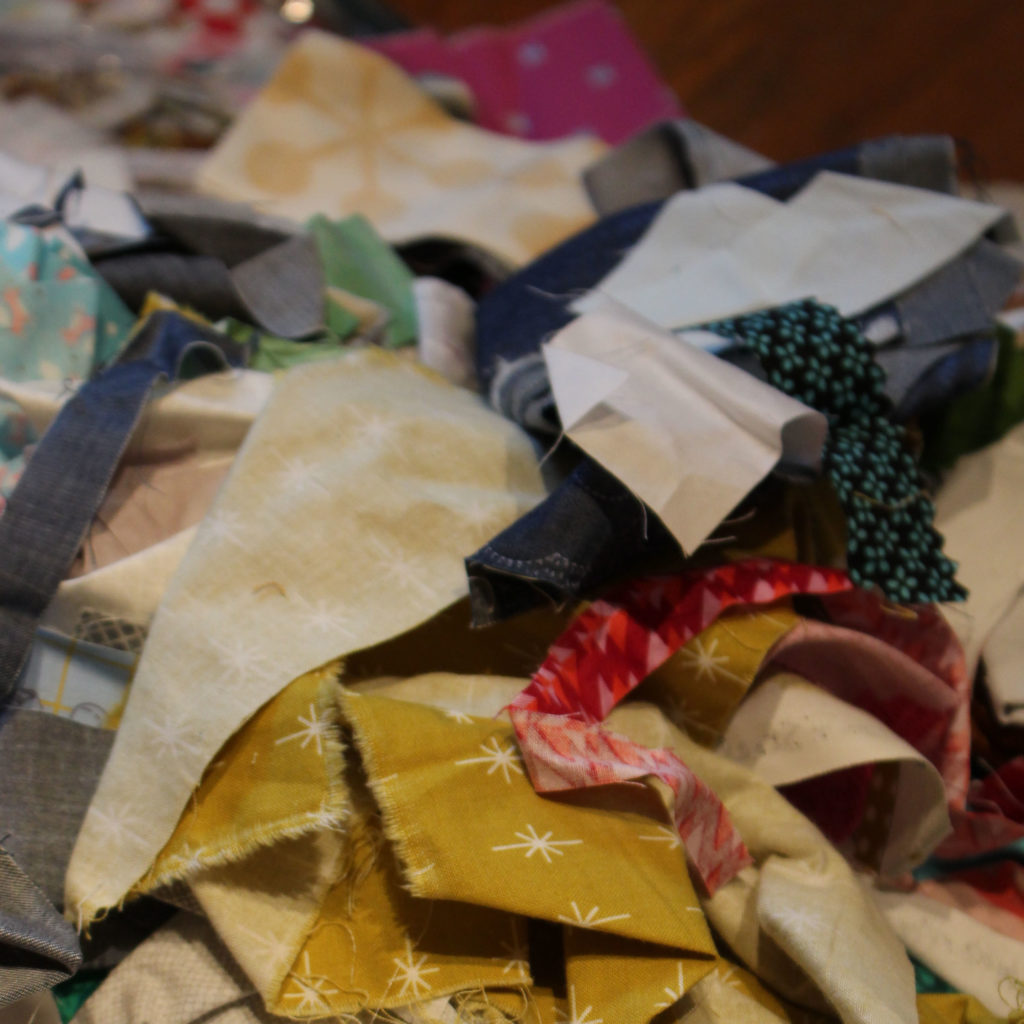 This is just one of the many bags of scraps I've collected over my years of quilting.