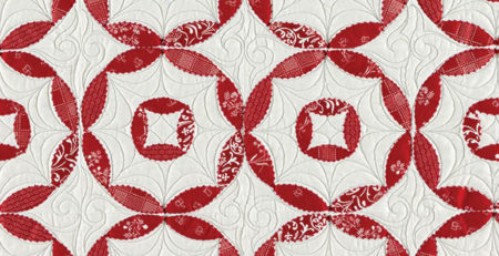 Detail of red and white machine applique
