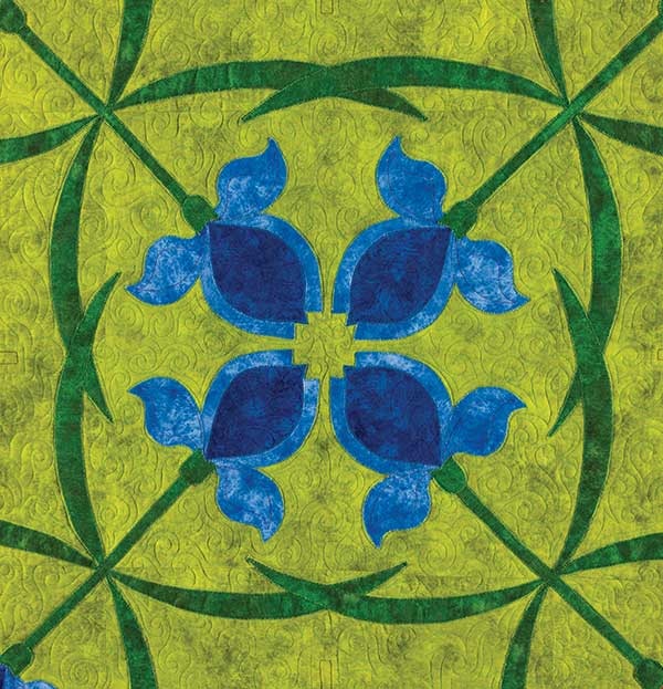 Linda used a hemstitch to appliqué around the edges of the flowers in her in Iris bed Quilt in Mountain Mist Historical Quilts.