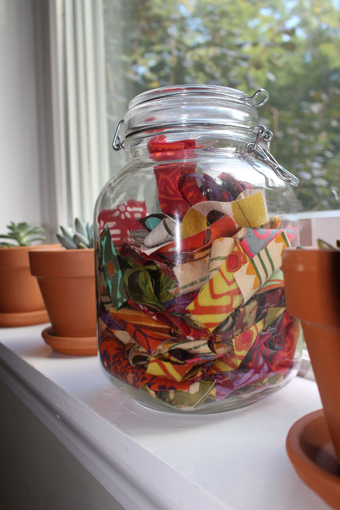 I keep lots of snips and scraps in jars.