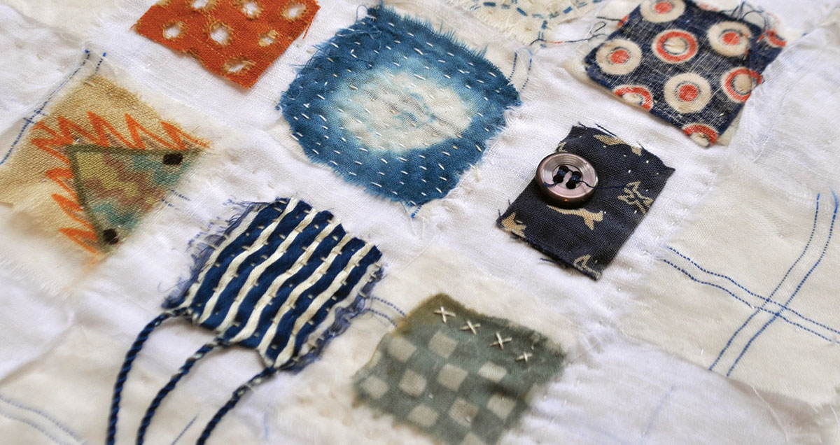 Detail of a nine-patch fragment mini quilt by Jude Hill.