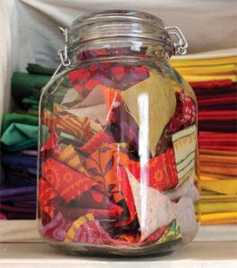 Jar of scrap fabric in Vivika's studio.